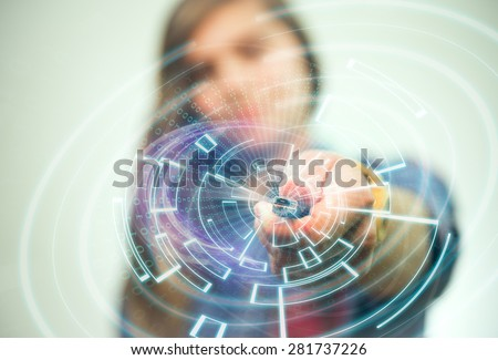 Girl is holding USB memory stick in her left hand. Futuristic lights in the foreground are visible. - stock photo