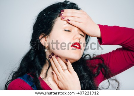 girl is ill with angina virus, isolated on a gray background - stock photo