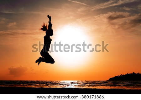 Girl is jumping on the Sunset