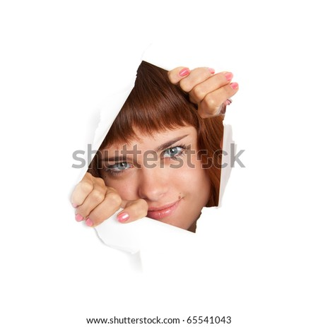 Girl is looking through a hole. Isolated on white background - stock photo