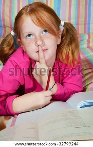 Girl is making homework - stock photo