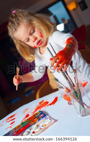 girl is painting - stock photo