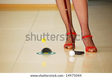 girl is playing golf in the office - stock photo