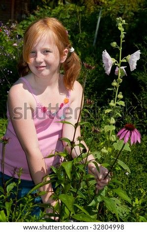 Girl is plucking flowers in the garden