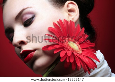 girl is relaxing and holding red flower - stock photo