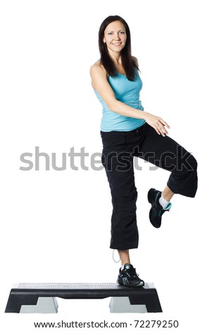 Girl is working out. Isolated on white - stock photo