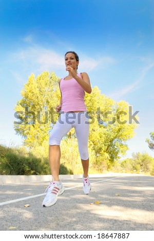 girl jogging on a road - stock photo