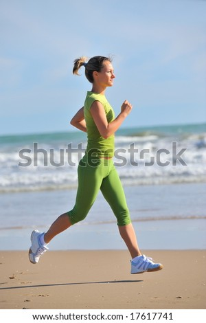 girl jogging on the beach - stock photo