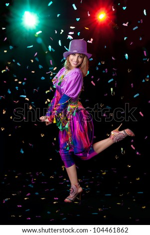 Girl jumping dancing confetti - stock photo