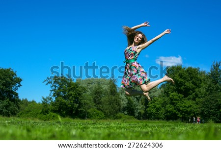 girl jumping on a background of blue sky - stock photo