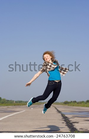 girl jumping on airstrip