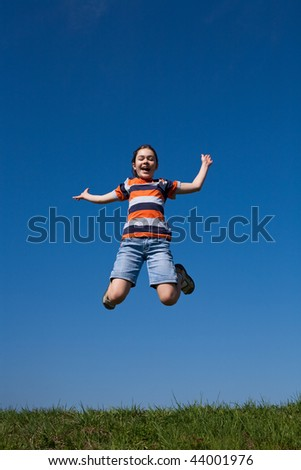 Girl jumping outdoor against blue sky