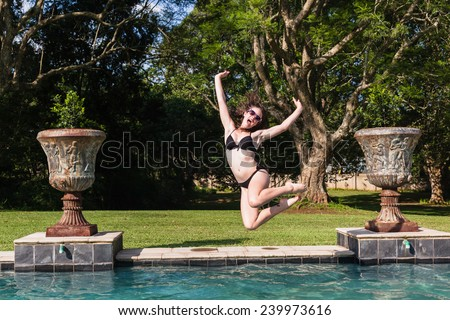 Girl Jumping Pool Girl Teenager running jumping into swimming pool summer playtime - stock photo