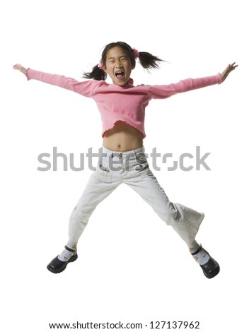 Girl jumping with her arms outstretched