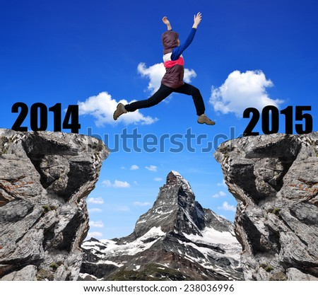 Girl jumps to the New Year 2015 in the background mount Matterhorn  - stock photo