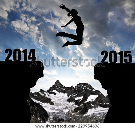 Girl jumps to the New Year 2015 in the background mount Ober Gabelhorn - stock photo