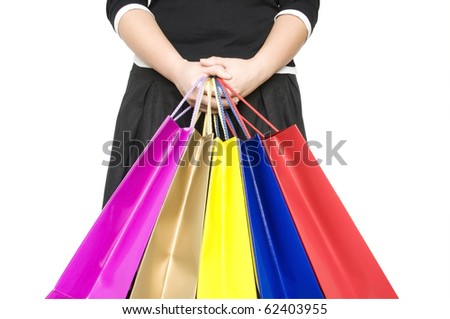 girl keep shopping bags in hands isolated on white