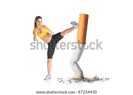 Girl kicking a cigarette butt isolated against white background - stock photo