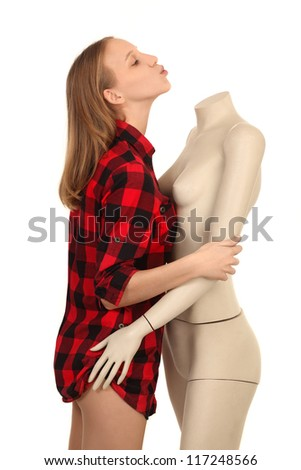 girl kissing a mannequin without head