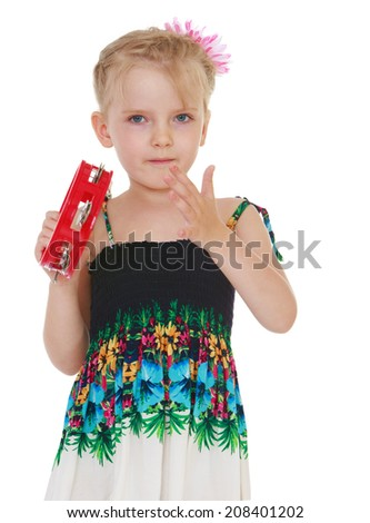 girl knocks on the red drum.kindergarten, the concept of childhood and joy, teens - stock photo