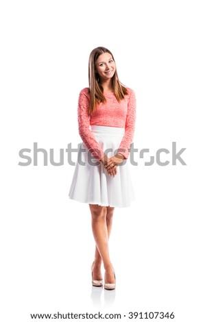 Girl, lace top, white skirt, heels, studio shot, isolated - stock photo