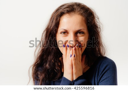 Girl laughs and covers her mouth - stock photo