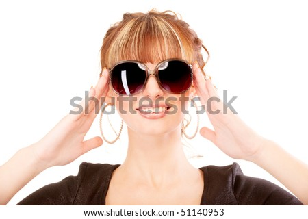 Girl laughs, holding sun glasses, isolated on white background. - stock photo