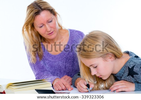 girl learning together with teacher in the classroom