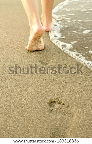 Girl leaves footprints in the sand