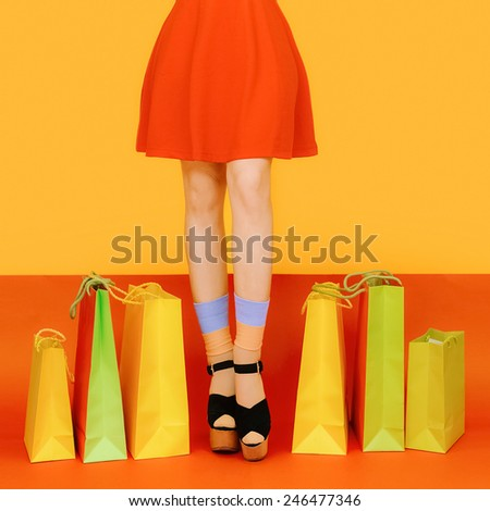 Girl legs colorful crazy Shopping style - stock photo