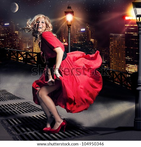 girl like Marylin Monroe standing in the wind - stock photo