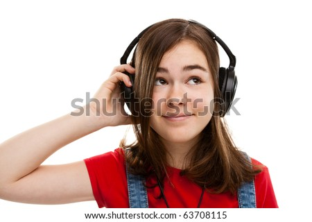 Girl listen to music isolated on white background - stock photo