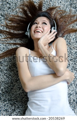 girl listening and enjoying music - stock photo