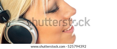 Girl listening music through headset isolated on white background.