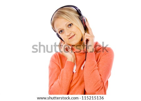 girl listening to music in headphones isolated on white background - stock photo