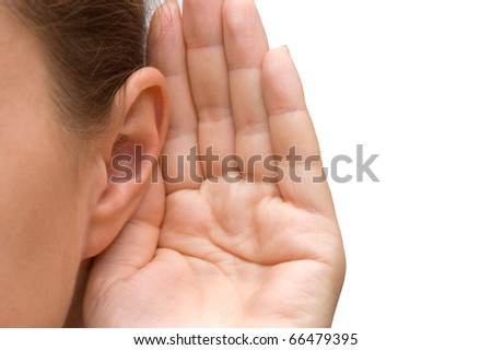 Girl listening with her hand on an ear - stock photo