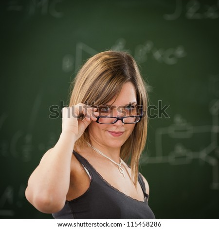 Girl looking above her reading glasses - stock photo