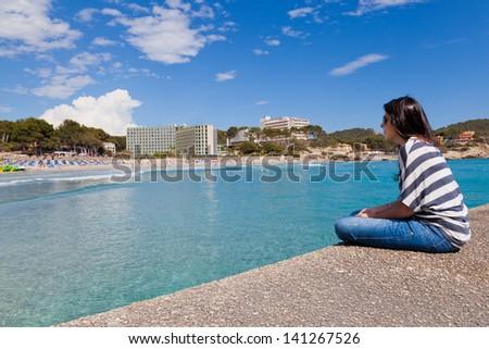 Girl Looking at Paguera Beach, Mallorca, Spain - stock photo