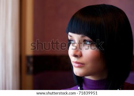 girl looking in window face portrait - stock photo
