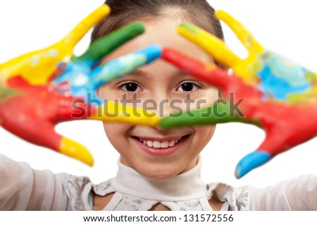 girl looking through a hand covered in paint