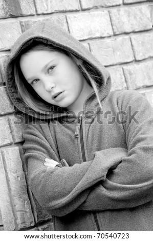 girl looking upset wearing jacket - stock photo