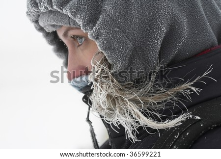 Girl looks away at cold winter day - stock photo