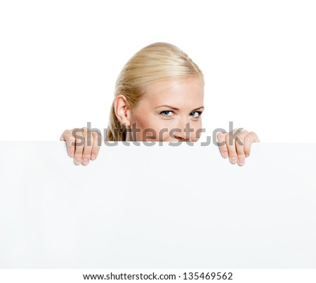 Girl looks out of the huge sheet of paper - copyspace for the text, isolated on white - stock photo