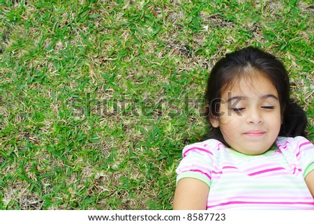 Girl Lying on the Green Grass - stock photo
