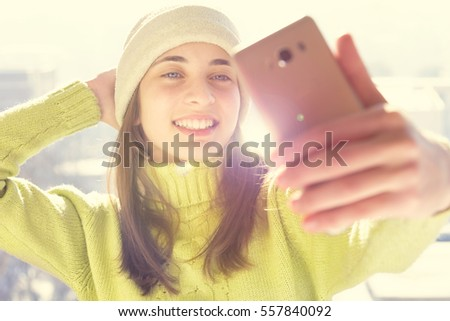 Girl makes a selfie with winter