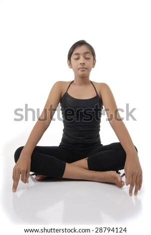 Girl makes yoga pose over white background