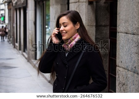 Girl making a phone call on the street - stock photo