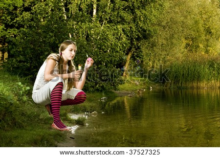 girl making bubbles in the park