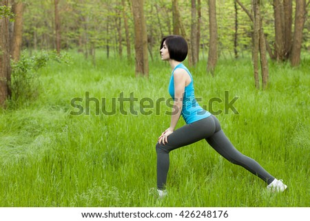 Girl making exercises in the forest
