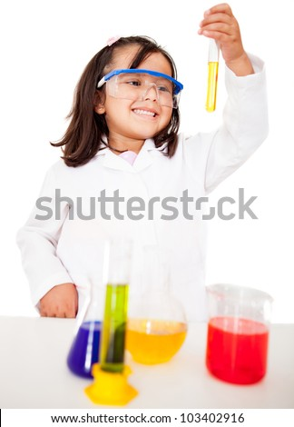 Girl making experiments in the laboratory - isolated over white - stock photo